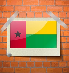 Flags guineabissau scotch taped to a red brick vector