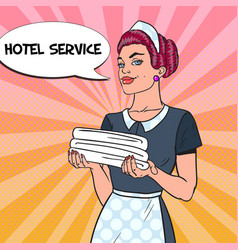 Female chambermaid with clean towels pop art vector