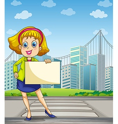 A woman at the pedestrian lane holding an empty vector image vector image