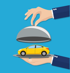 hand opens serve cloche with yellow car inside vector image