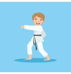 Boy doing fist kick in white kimono on karate vector