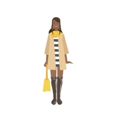 Young woman in autumn fashionable street look vector