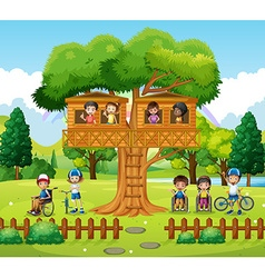 Children playing at the treehouse in the park vector