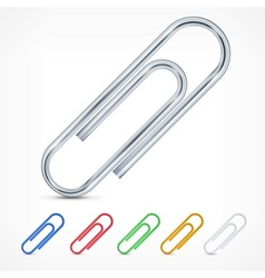 Metallic color paperclips on white vector