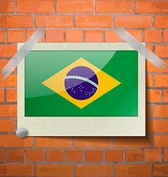 Flags brazil scotch taped to a red brick wall vector