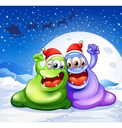 A green and a violet monster wearing a red hat for vector image vector image