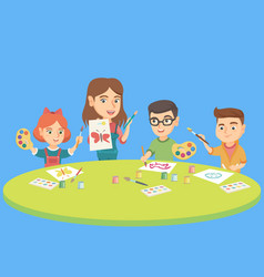 children drawing with teacher at preschool class vector image