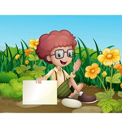 A smiling young boy near the flowers holding an vector image vector image