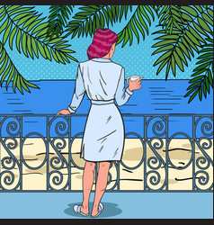 Woman drinking coffee at the balcony pop art vector