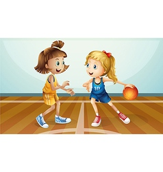 Two young ladies playing basketball vector image