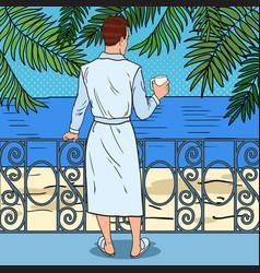 Man drinking coffee at the balcony pop art vector
