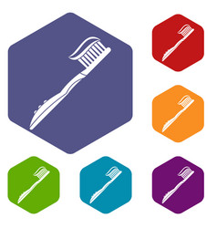 Toothbrush with toothpaste icons set hexagon vector