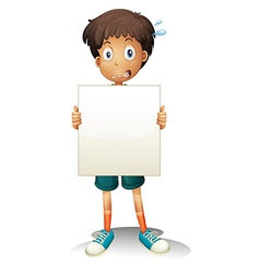 A worried young boy holding an empty signage vector image