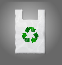 Blank white plastic bag with green recycling sign vector image