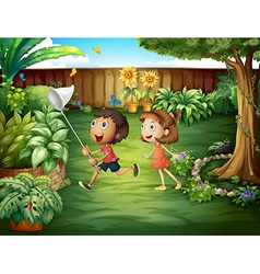 Two friends catching butterflies at the backyard vector image vector image