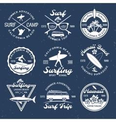 Surfing emblems on dark vector