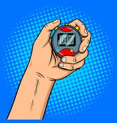 Hand with stopwatch pop art vector