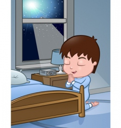 Little boy praying vector