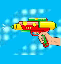 hand with water gun pop art vector image