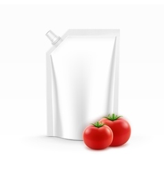 Plastic pack of tomato ketchup with fresh tomatoes vector