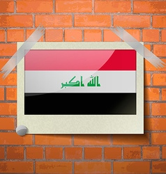 Flags iraq scotch taped to a red brick wall vector