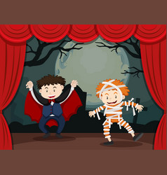 Two boys in halloween costume on stage vector