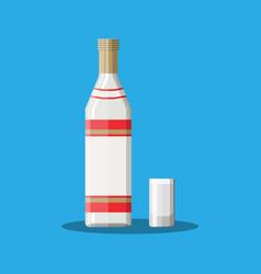 Bottle of vodka with shot glass vector