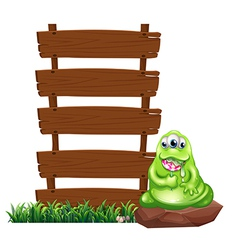 A monster beside the empty wooden boards vector image