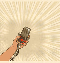 female hand with retro microphone vector image