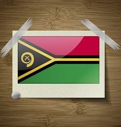 Flags vanuatu at frame on wooden texture vector