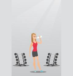 Sportswoman drinking water vector