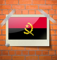 Flags angola scotch taped to a red brick wall vector