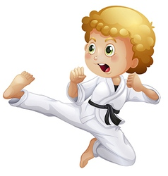 A cute little boy doing karate vector image
