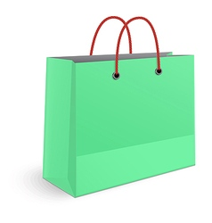 Classic shopping green paper bag with red grips vector