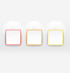 Blank boards with color frames on wall vector image