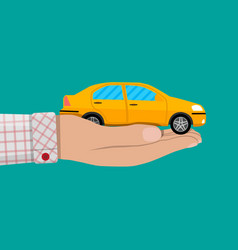 Hand with yellow car vector
