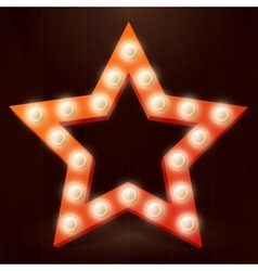 Red star with retro bulb light vector