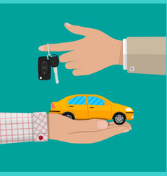 Hand with yellow car and keys vector