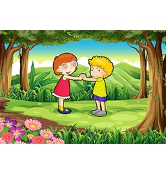 Kids playing at the jungle vector image