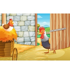 A rooster and a hen at the barnhouse vector image