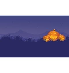 Orange pumpkins in hills halloween backgrounds vector