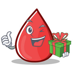 With gift blood drop cartoon mascot character vector