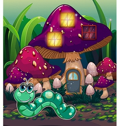 A worm near the mushroom house vector