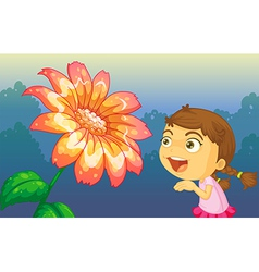 A girl playing in front of the giant flower vector image