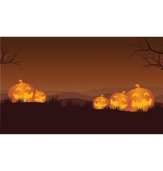 Silhouette of halloween orange pumpkins in hills vector