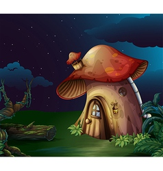 A big mushroom house at the forest vector