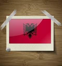 Flags albania at frame on wooden texture vector