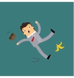 Businessman slipping on a banana vector
