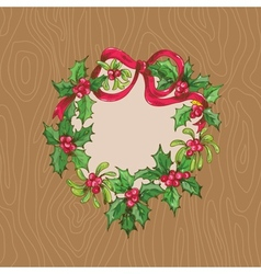 Christmas card with wrath on a wooden background vector