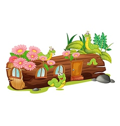 Caterpillars and a wood house vector image